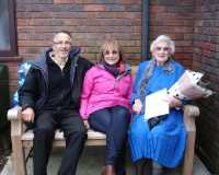 Joan with Keith and Barbara on her bench 2014